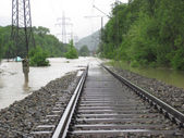 The Flooded Straight Railway Track with Timber Sleepers — Stock Photo