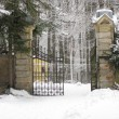Open fence with footprints in snow winter — Stock Photo
