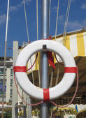 White lifebuoy with ropes are hanging on a mast — Stock Photo