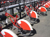 Bike Sharing in Barcelona, Spain. Long row of red and white publ — Stock Photo