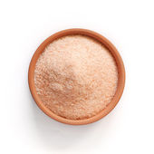 Special pink salt from the Himalayas, in a small bowl isolated on white — Stock Photo
