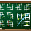 Stock Vector: Tic tac toe variations on chalkboard