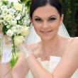 Beautiful bride with a bouquet — Stock Photo