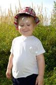 Happy child closes eyes — Stock Photo