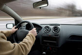 Man driving car on road, blurred motion — Stock Photo