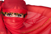 Portrait of young woman wearing traditional red veil — Stock Photo