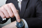 Businessman pointing at his watch — Stock Photo