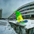Snowboarding in the city — Stock Photo