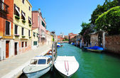Aquamarine canal with boats in Venice — Stock Photo