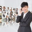 Young businessman talk on phone — Stock Photo #23229696