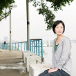 Woman sit on bench — Stock Photo