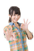 Young asian woman showing OK gesture. — Stock Photo