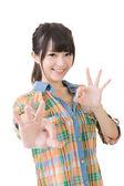 Young asian woman showing OK gesture. — Foto de Stock