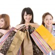Stock Photo: Asishopping women with bags