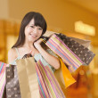 Happy shopping asian woman — Stock Photo