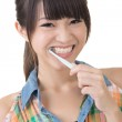 Asian woman brushing teeth. — Stock Photo #30791421
