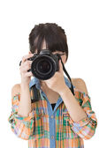 Asian woman takes images with photo camera — Stock Photo