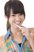 Asian woman brushing teeth. — Stock Photo