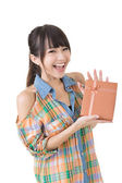 Young smiling asian woman with a gift. — Stock Photo