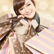 Stock Photo: Smiling shopping girl