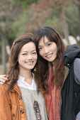 Happy smiling Asian women in the park — Stock Photo
