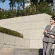 Confident Asian business woman standing in outside of office in — Stock Photo #39855181