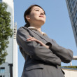Confident Asian business woman standing in outside of office in — Stock Photo #39855307