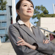 Confident Asian business woman standing in outside of office in — Stock Photo #39855397