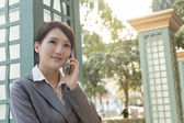 Asian business woman talking on smartphone with copyspace — Stock Photo