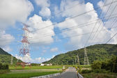 Power lines in countryside — Stock Photo