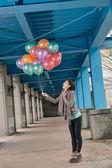 Cheerful Asian beauty holding balloons — Stock Photo
