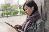 Woman using a pad — Stock Photo