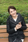 Woman using smartphone — Stock Photo