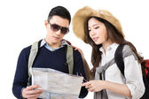 Young Asian couple travelers looking the map — Stock Photo