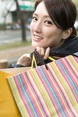 Asian young woman shopping — Stock Photo