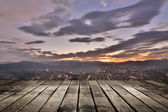 City sunset with wooden ground — Stockfoto