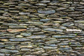 Stone wall with green moss — Stock Photo