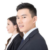 Side view of young business man and woman — Stock Photo