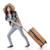 Exciting Asian woman drag a luggage — Stock fotografie