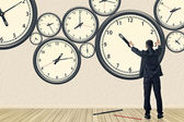 Asian business repair the clock — Stock Photo