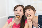 Happy friends eating — Stock Photo