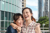 Asian woman with friends — Stock Photo