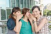 Asian friends' whisper — Stock Photo