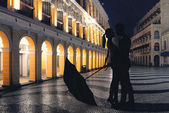 Couple standing in the raining street — Stock Photo