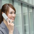 Business woman using cellphone — Stock Photo #5486560