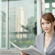 Young business woman reading newspaper — Stock Photo #5486568