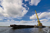 Port crane and barge — Stock Photo