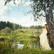 Photo of romantic woman in fairy forest - Stock Photo