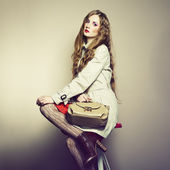 Portrait of a beautiful young woman with a handbag — Stok fotoğraf