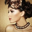 Retro portrait of a beautiful woman. Vintage style - Stock Photo
